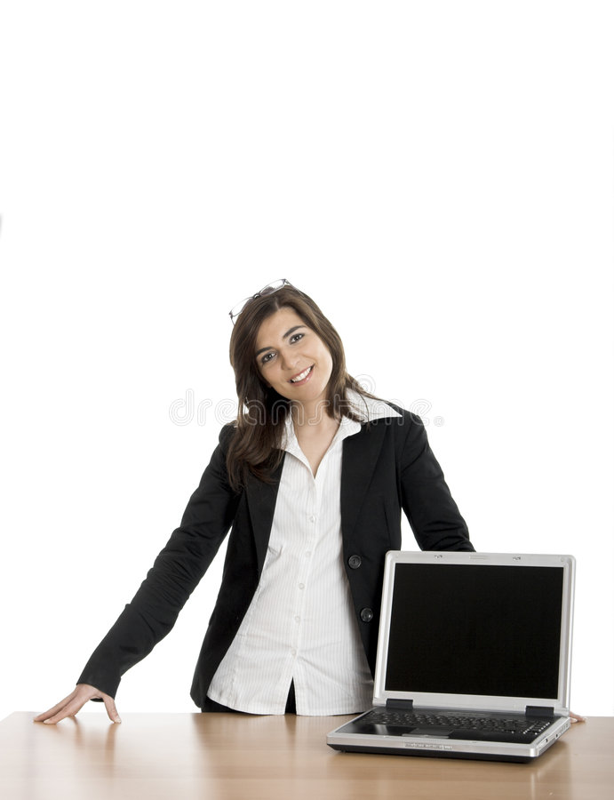 Business woman. Beautiful business woman showing a presentation on the laptop royalty free stock photo