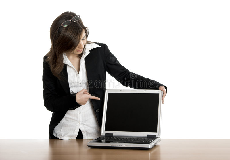 Business woman. Beautiful business woman showing a presentation on the laptop royalty free stock photos