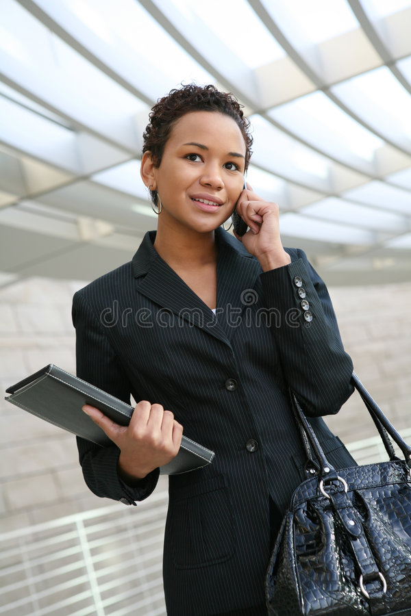 Business Woman. An african american business woman on the cell phone stock photo