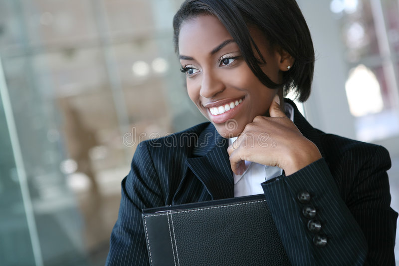 Business Woman. A pretty african american business woman at her company royalty free stock image
