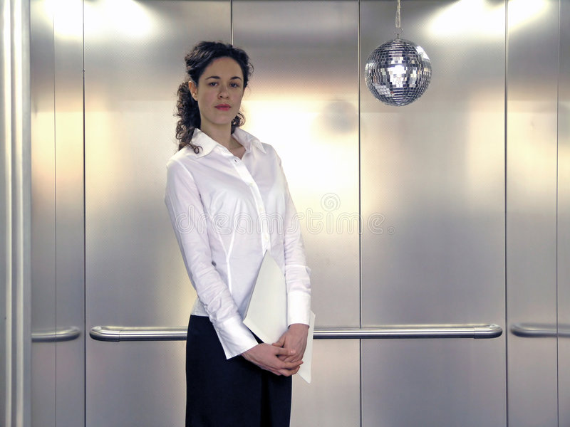 Business Woman. In Elevator With File Folder stock photo
