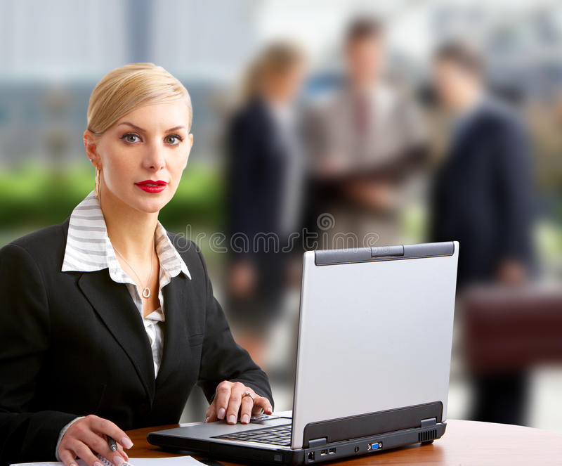 Business woman. And business people working with laptop royalty free stock image