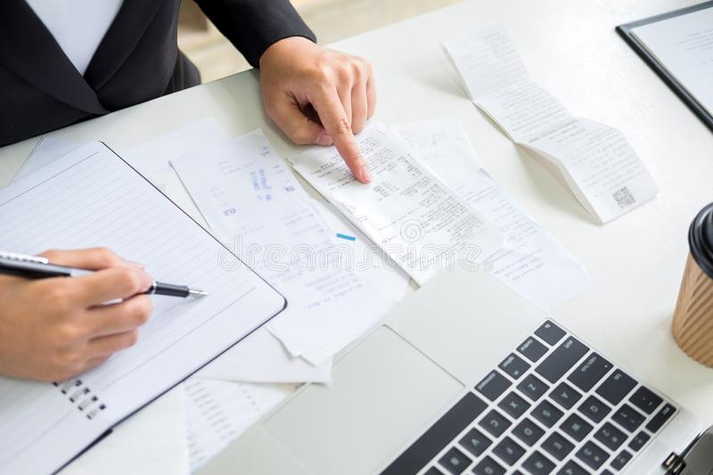 Business woman accountant or banker making calculations Bills. doing finances in the office, economy concept through laptop royalty free stock photo