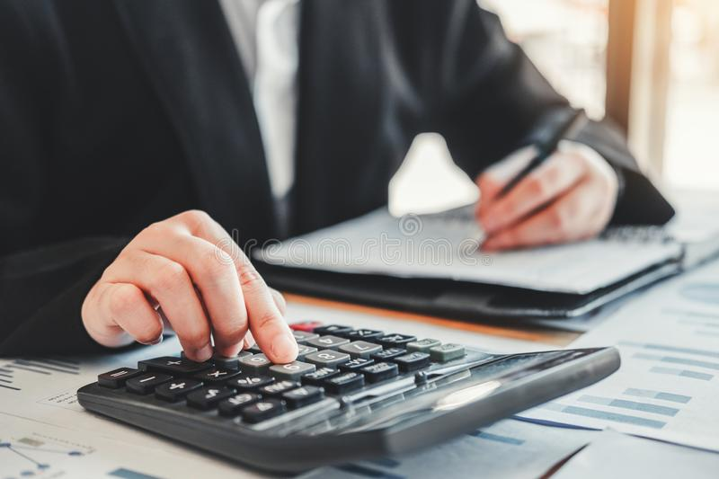 Business woman  Accounting Financial investment on calculator Cost Economic business and market royalty free stock image