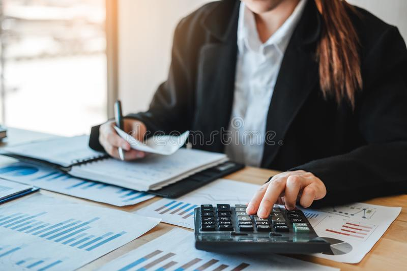 Business woman  Accounting Financial investment on calculator Cost Economic business and market stock photo