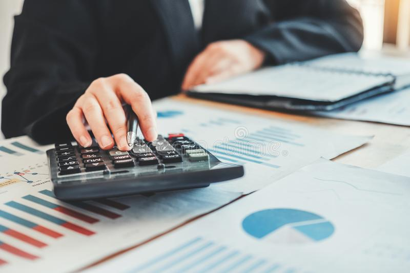 Business woman Accounting Financial investment on calculator Cost Economic business and market stock image