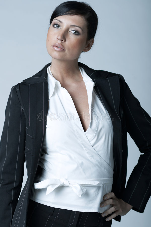 Business Woman Ag. Beautiful and brunette business woman isolated on clear background royalty free stock photo