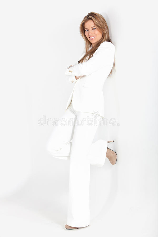 Business woman against a wall