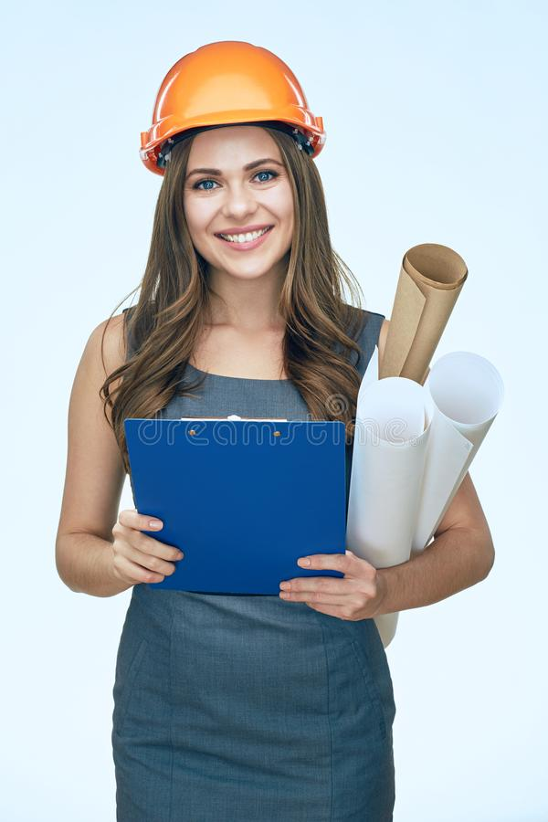 Business woman architect holding blueprints and clipboard. Isolated portrait. stock photos
