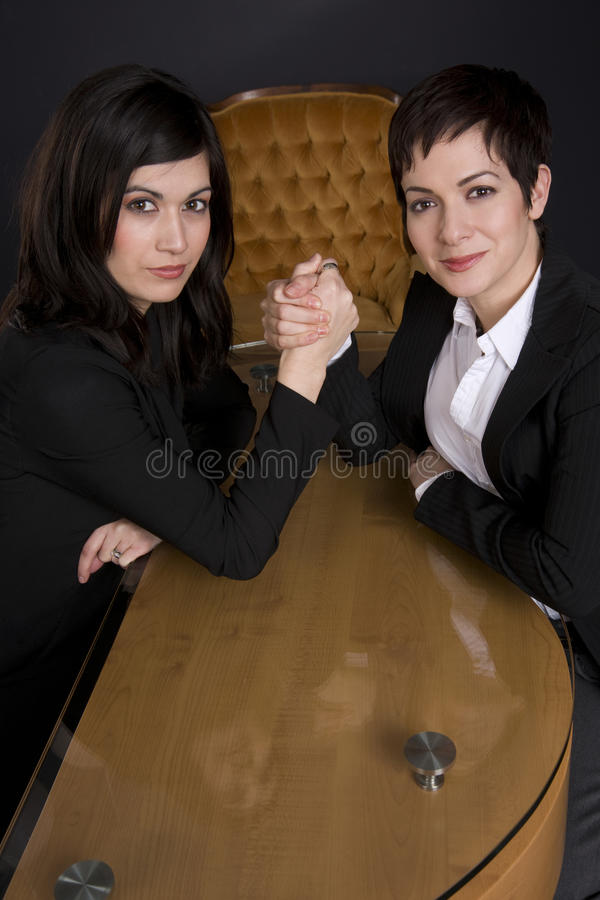 Business Woman Arm Wrestle Professional Contest. Two Business Woman Arm Wrestle in the office stock images