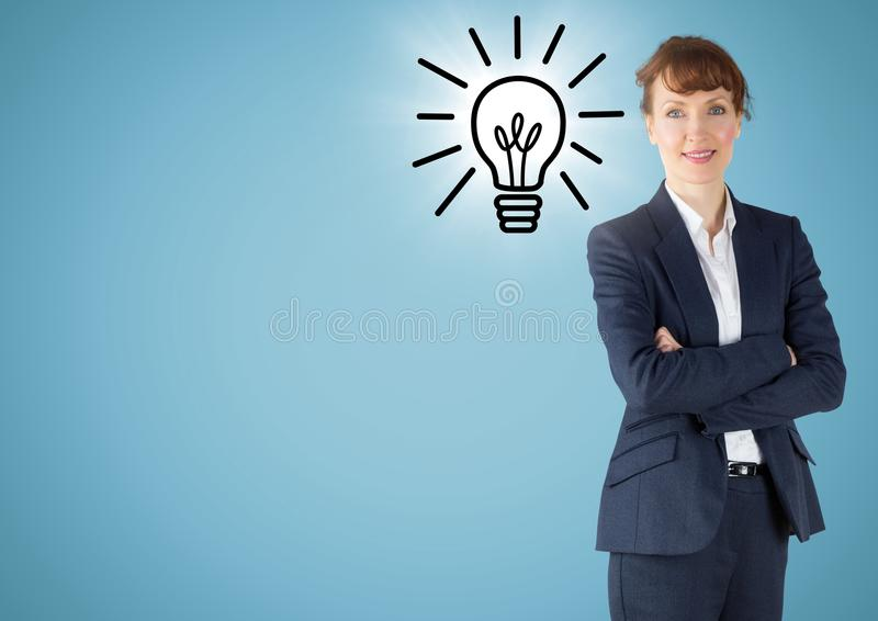 Business woman arms folded with lightbulb doodle and flare against blue background stock photos