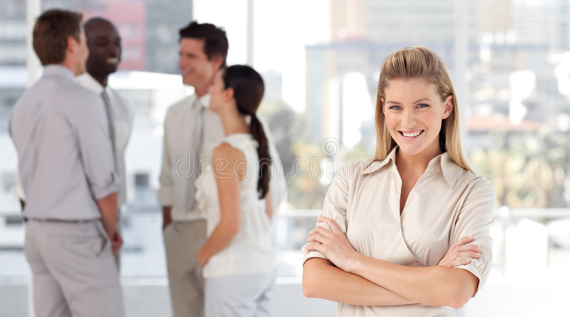 Download Business Woman With Associates Smiling Stock Image - Image: 9098655