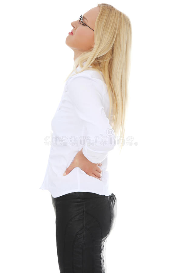 Business woman with back pain stock photography