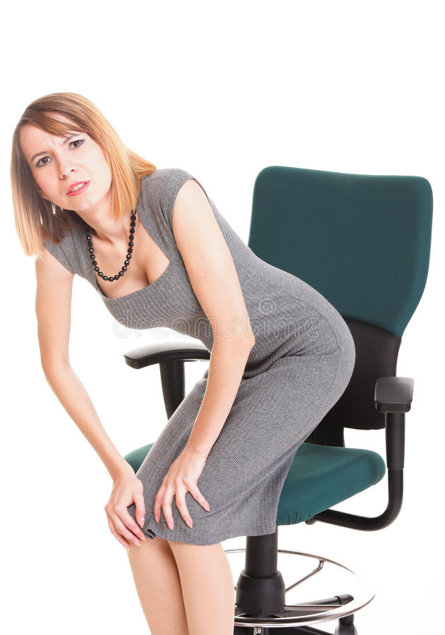 Business Woman With Back Pain After Long Work On Chair