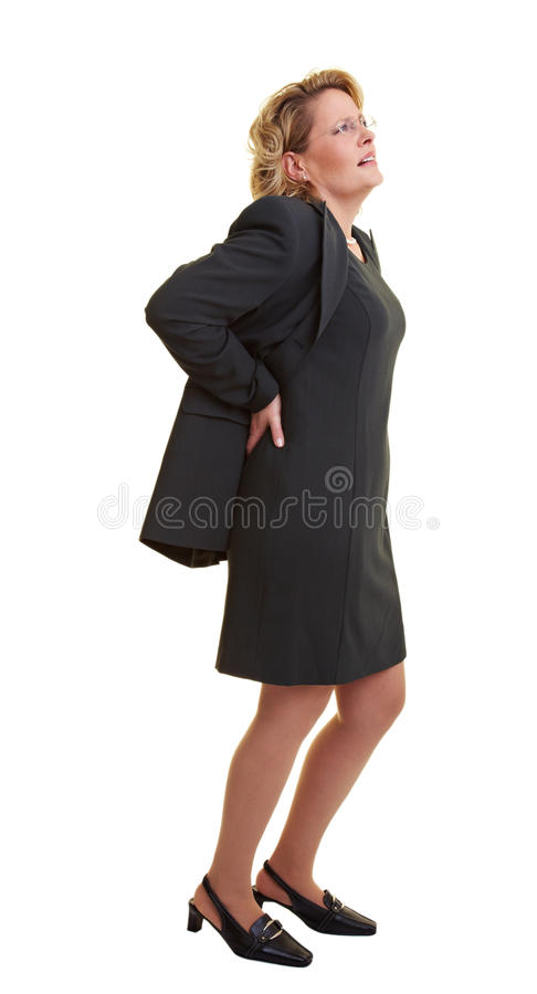 Business woman with backache. Business woman pressing her hands against her back royalty free stock photo