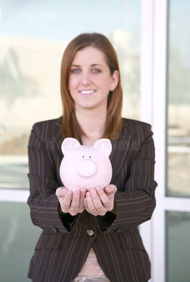 Business Woman And Bank (focus On Piggy Bank) Stock Photography
