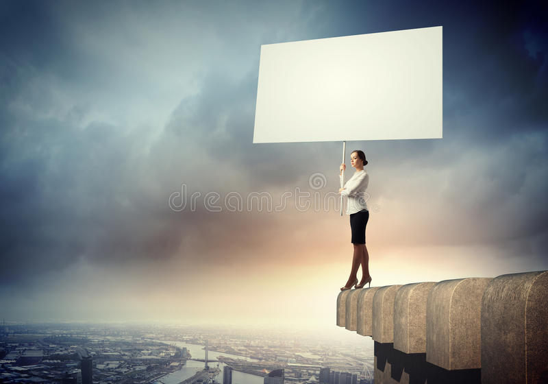 Business woman with banner royalty free stock photo