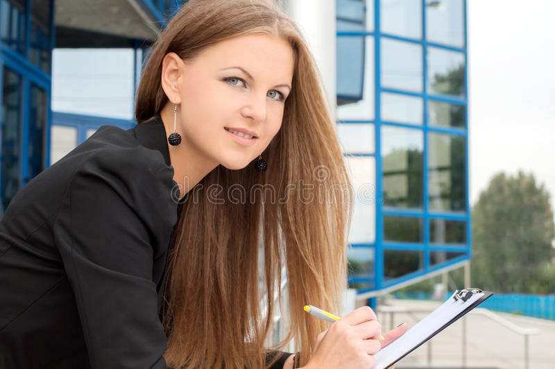 Business Woman. Beautiful business woman on the background of the modern office royalty free stock photos