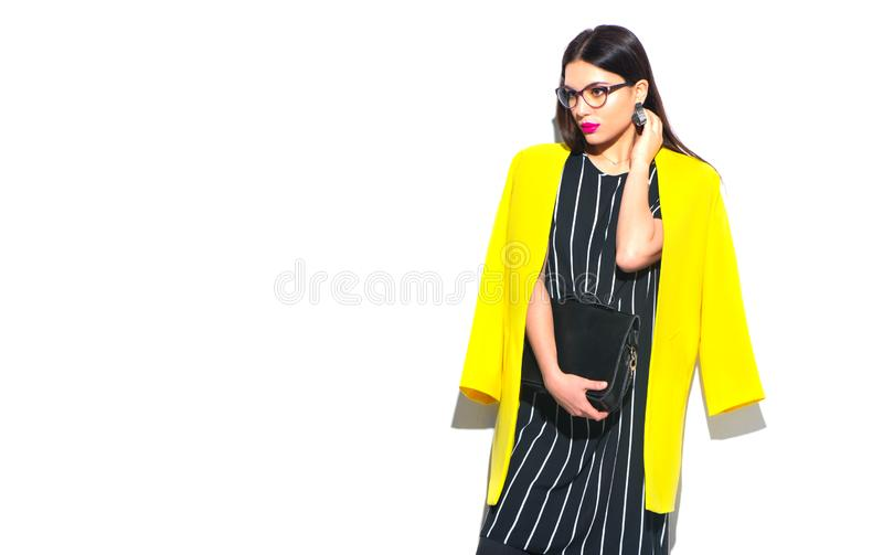 Business woman. Beauty sexy model girl in trendy yellow wearing glasses,  on white. Background royalty free stock images