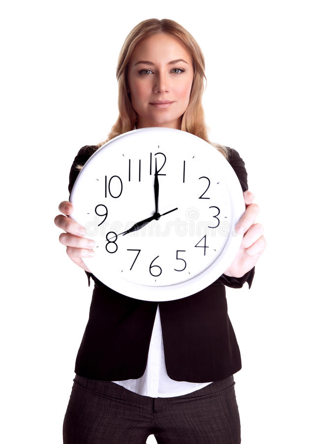Business woman with big clock. Portrait of serious business woman holding in hands big clock isolated on white background, eight o'clock, get up early in the stock photos