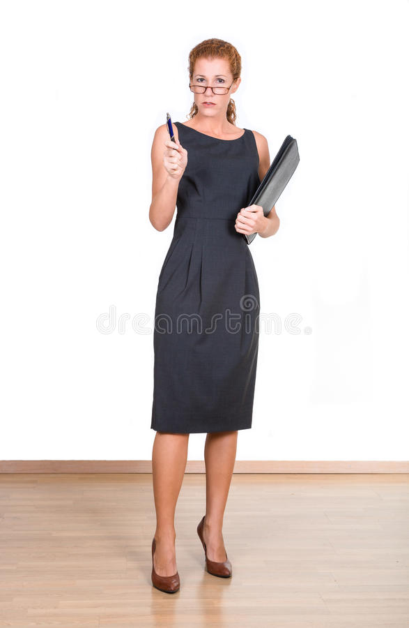 Business woman. In black costume stock photo