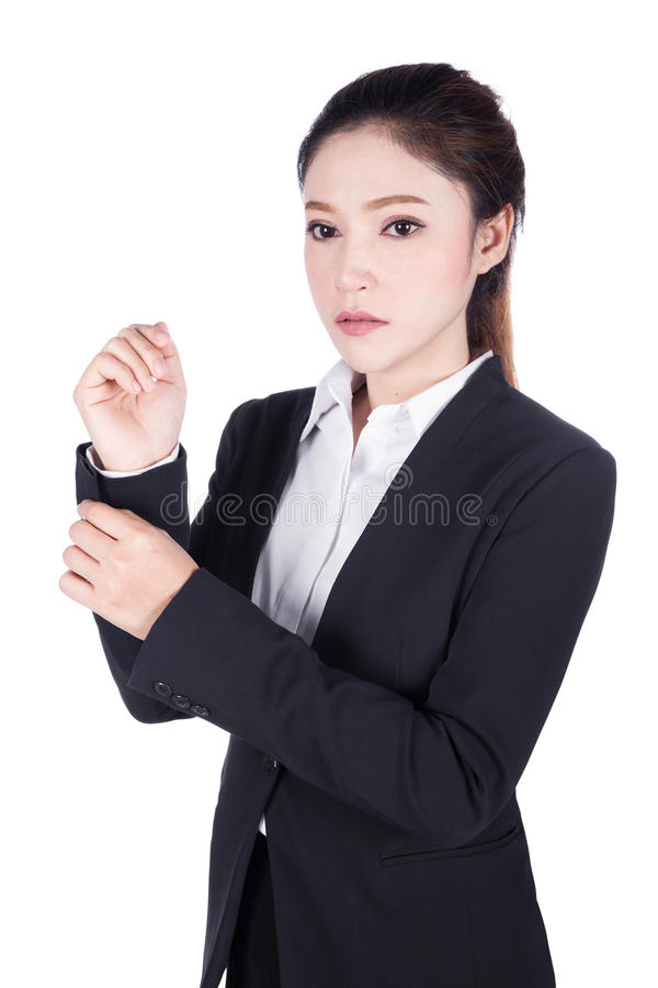 Business woman in black suit is dressing up isolated on white. Background royalty free stock images
