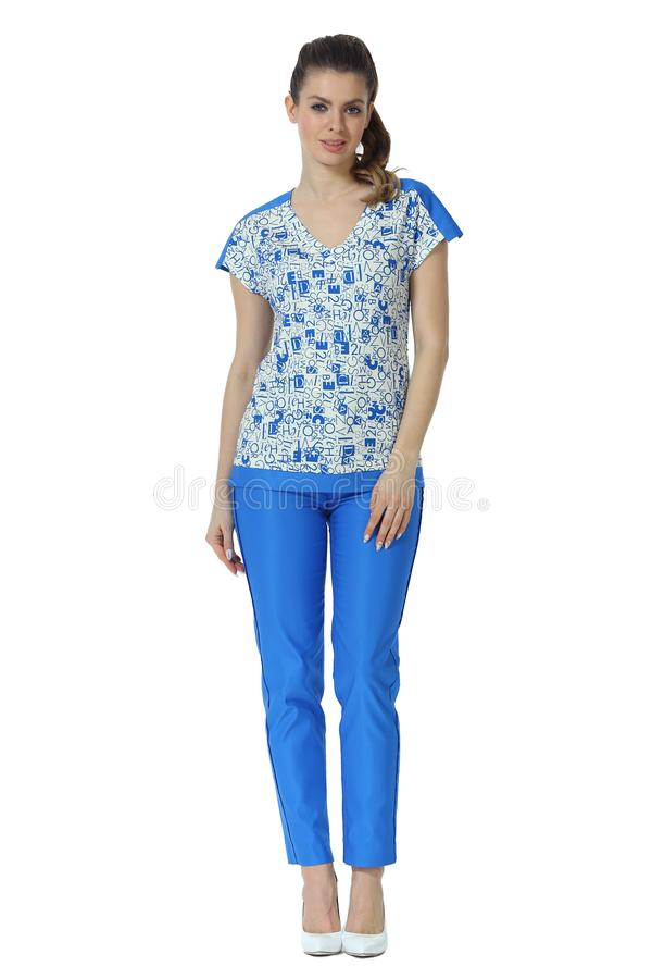 Business woman in blue print casual blouse trousers high heels stiletto shoes full body photo. Isolated on white stock images