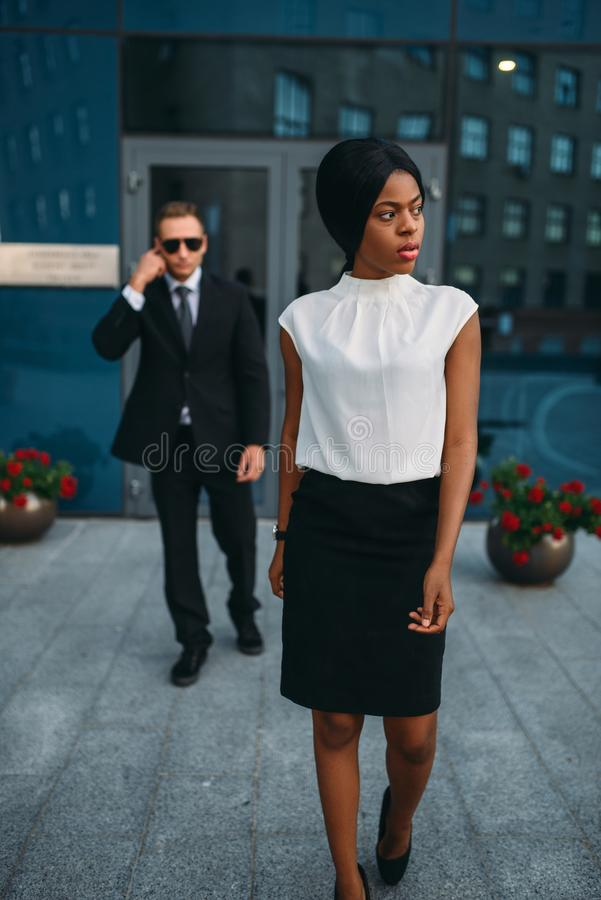 Business woman, bodyguard in suit on background royalty free stock photo