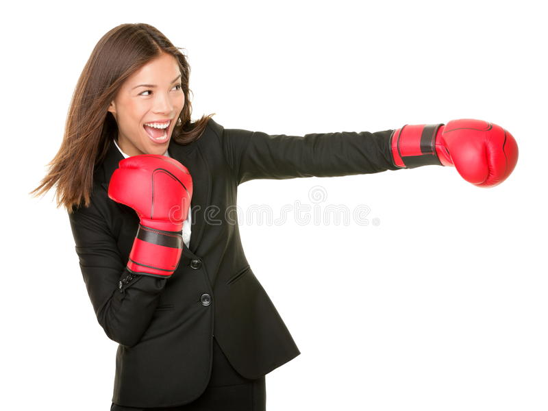 Business woman boxing. Concept. Businesswoman in suit punching with red boxing gloves isolated on white background royalty free stock photos