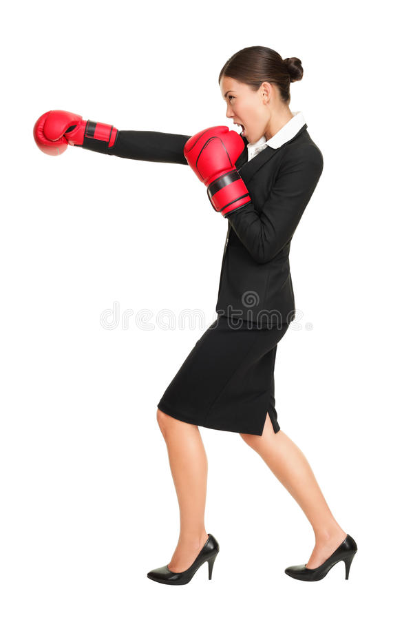 Business woman boxing. Business competition concept with businesswoman punching and hitting standing in full length profile. Young Asian / Caucasian female stock photos
