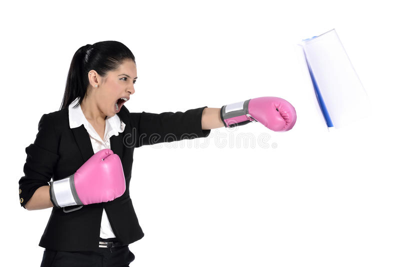 Business woman boxing. Concept. Businesswoman in suit punching with pink boxing gloves isolated on white background royalty free stock photo