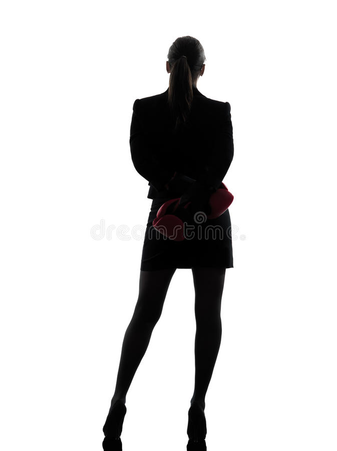 Business woman boxing gloves silhouette. One business woman with boxing gloves silhouette studio isolated on white background royalty free stock image