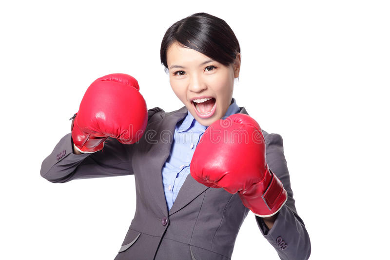 Business woman boxing ready to fight. Strength, power or competition concept image of beautiful strong Asian businesswoman isolated on white background royalty free stock photos
