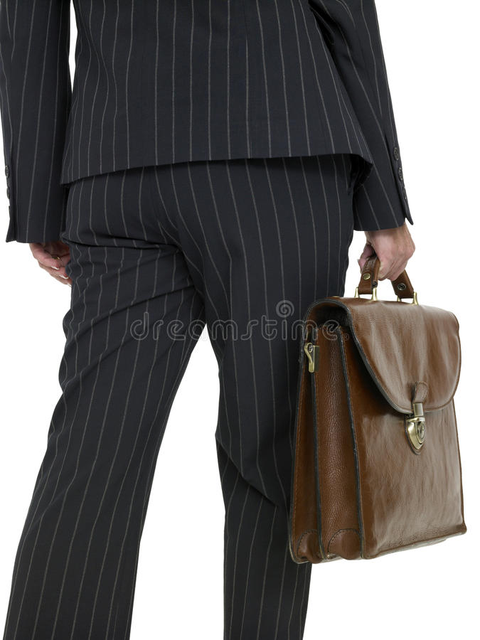 Business Woman with a briefcase, walking, rear view royalty free stock photo
