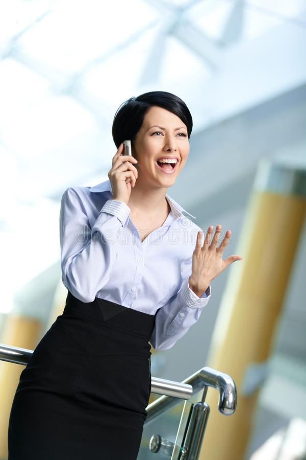 Business woman in business suit talks on phone royalty free stock image