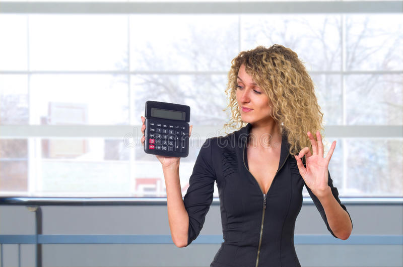 Download Business Woman With Calculator Stock Photo - Image: 26509568