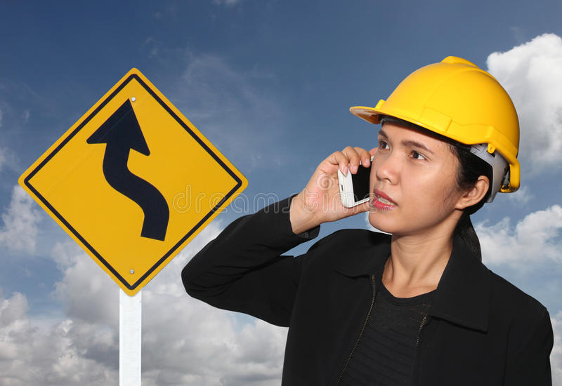 Business woman call Smartphone and traffic signs. Business woman call Smartphone and traffic signs on blue sky background stock photo