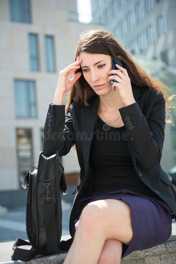 Business Woman Calling Phone - Problems Stock Photo