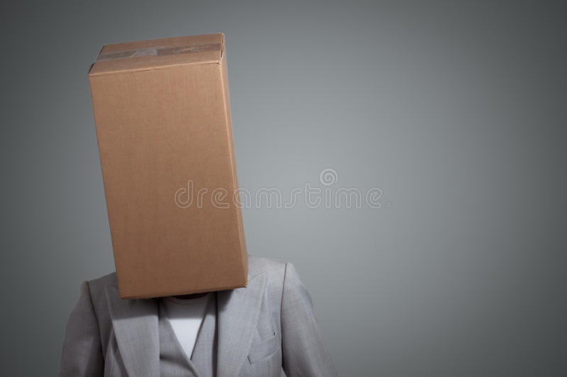 Business woman with a cardboard box head stock photography