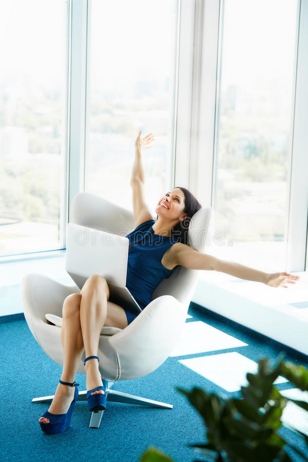 Business woman celebrates successful deal at office. Bussiness P stock image