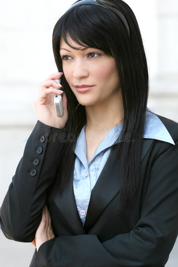 Business Woman on Cell Phone. Business woman outdoors talking on cell phone stock photography
