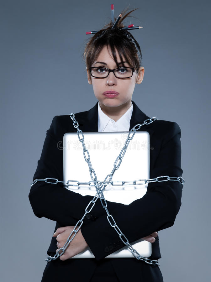 Business Woman Chained To Her  Her Computer Laptop Royalty Free Stock Photo