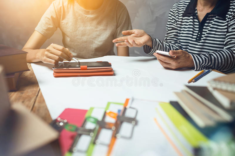 Business woman with colleague hardworking of work at home office. Delivery product service checking package box and documents data stock image