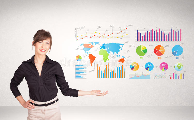 Business woman with colorful graphs and charts royalty free stock photo