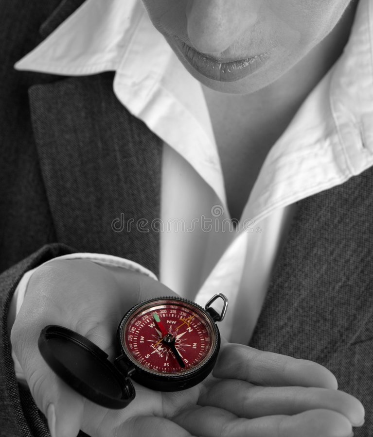 Business woman with compass in her hand royalty free stock images