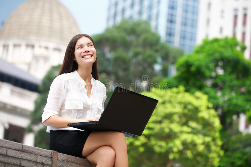 Business woman with computer laptop in Hong Kong. Business woman with computer laptop thinking looking up at copy space in business district, Central, Hong Kong stock images