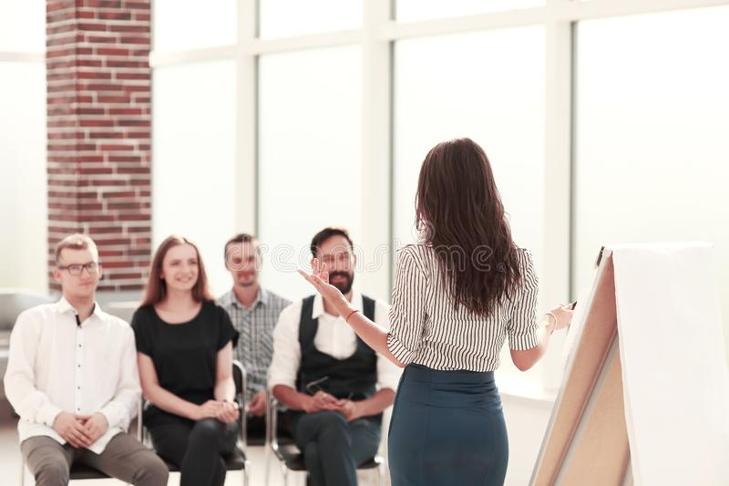 Business woman conducting a seminar for her business team royalty free stock image