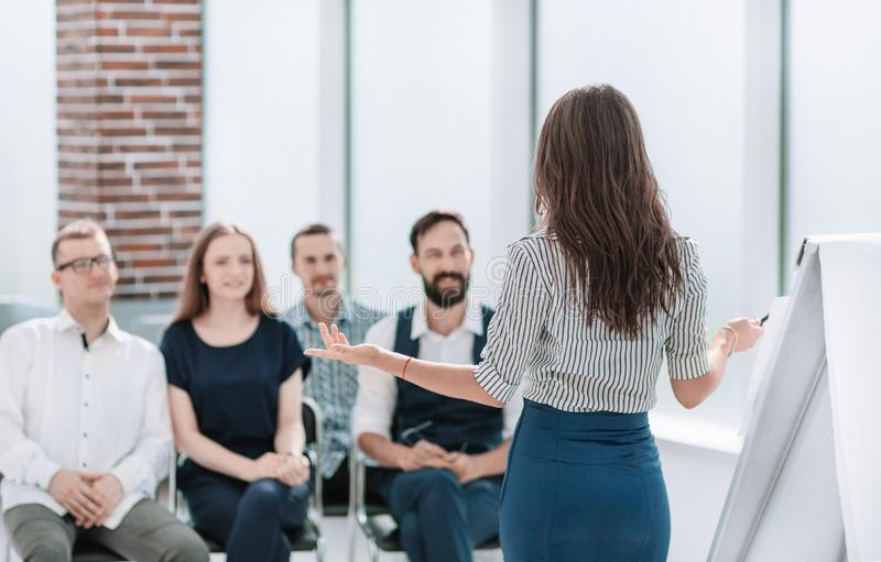 Business woman conducting a seminar for her business team stock image