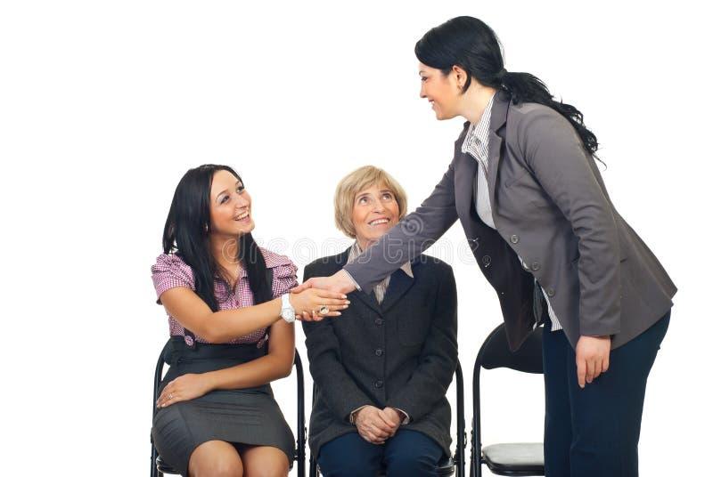 Business woman congratulate her colleague