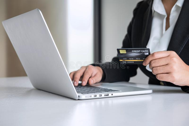 Business woman consumer holding credit card and typing on laptop for online shopping and payment make a purchase on the Internet, royalty free stock photography